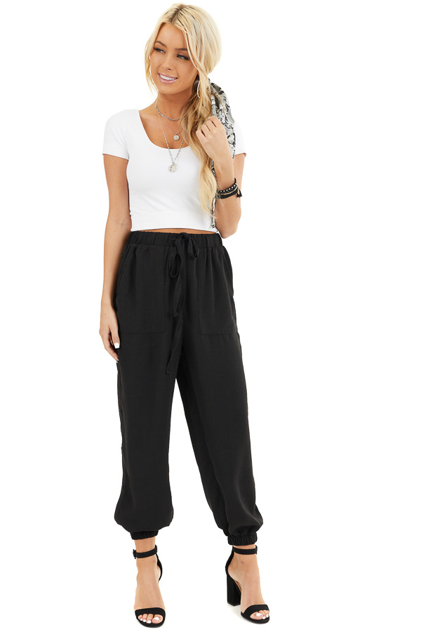 Black Jogger Pants with Elastic Waist and Side Button Detail front full body