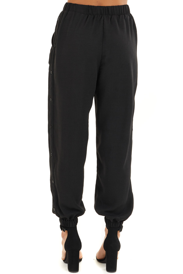 Black Jogger Pants with Elastic Waist and Side Button Detail back view