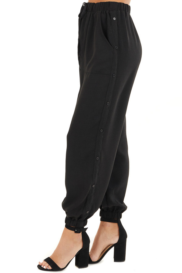 Black Jogger Pants with Elastic Waist and Side Button Detail side view