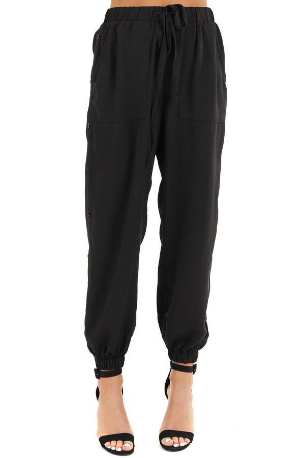 Black Jogger Pants with Elastic Waist and Side Button Detail front view