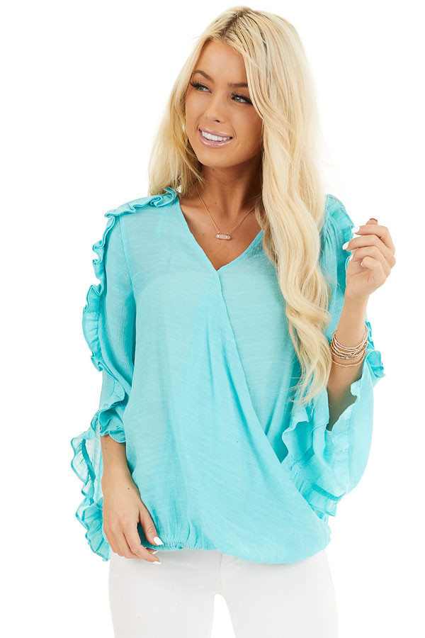Aqua Deep V Neck Blouse with Long Sleeve Ruffle Details front close up