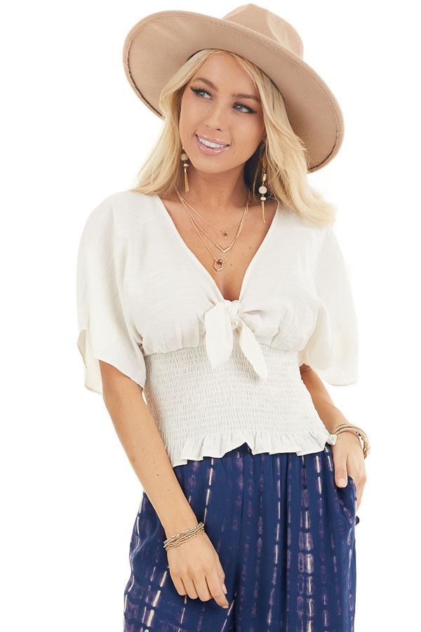 Cream Smocked Crop Top with Short Sleeves and Front Tie front close up