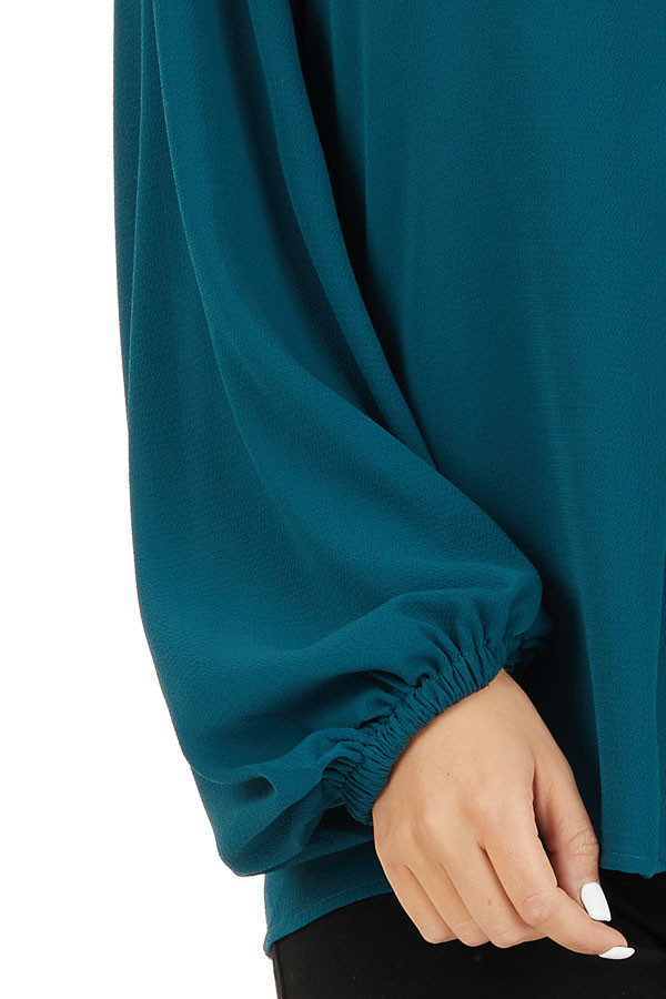 Dark Teal V Neck Woven Top with Long Puff Sleeves detail