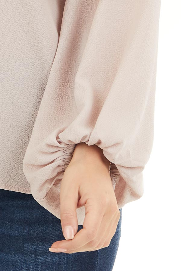 Latte V Neck Woven Top with Long Puff Sleeves detail