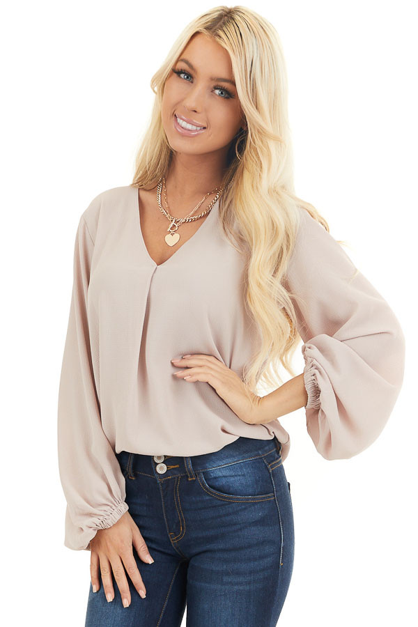 Latte V Neck Woven Top with Long Puff Sleeves front close up