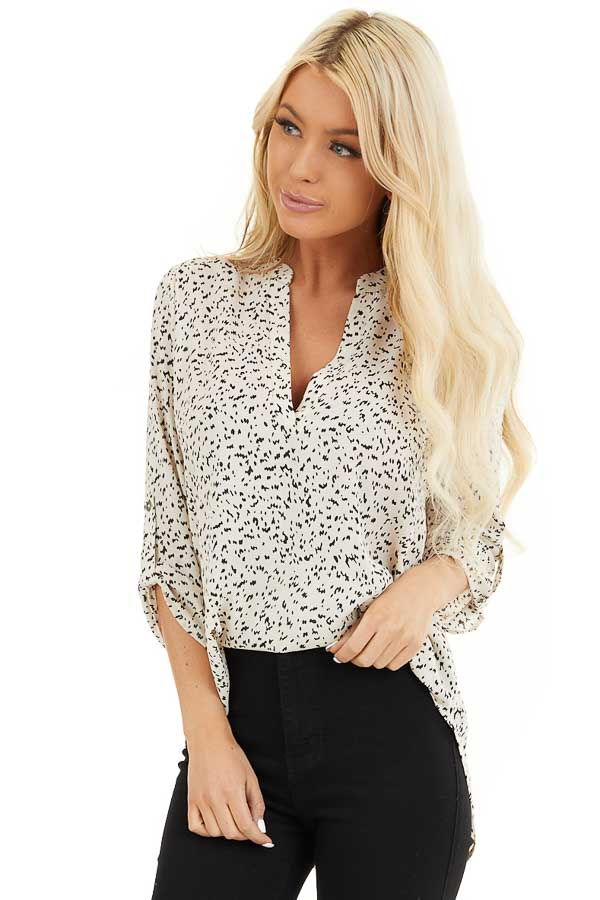 Cream and Black Speckled Woven Top with 3/4 Sleeves front close up