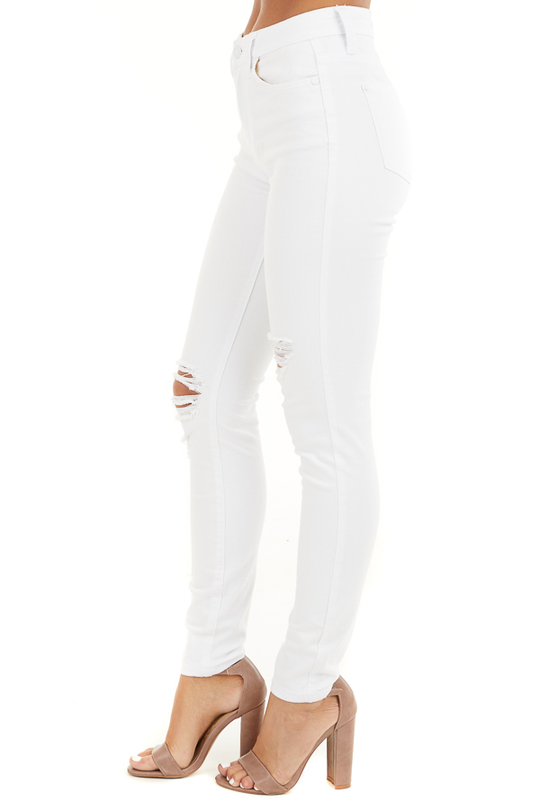 White High Rise Jeans with Distressed Knee Details side view