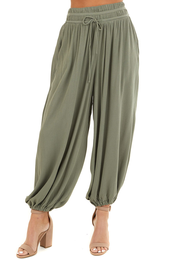 Faded Olive High Waisted Loose Pants with Elastic Hem front view