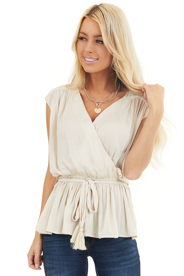 Champagne Surplice Top with Elastic Waistline and Tassel Tie front close up
