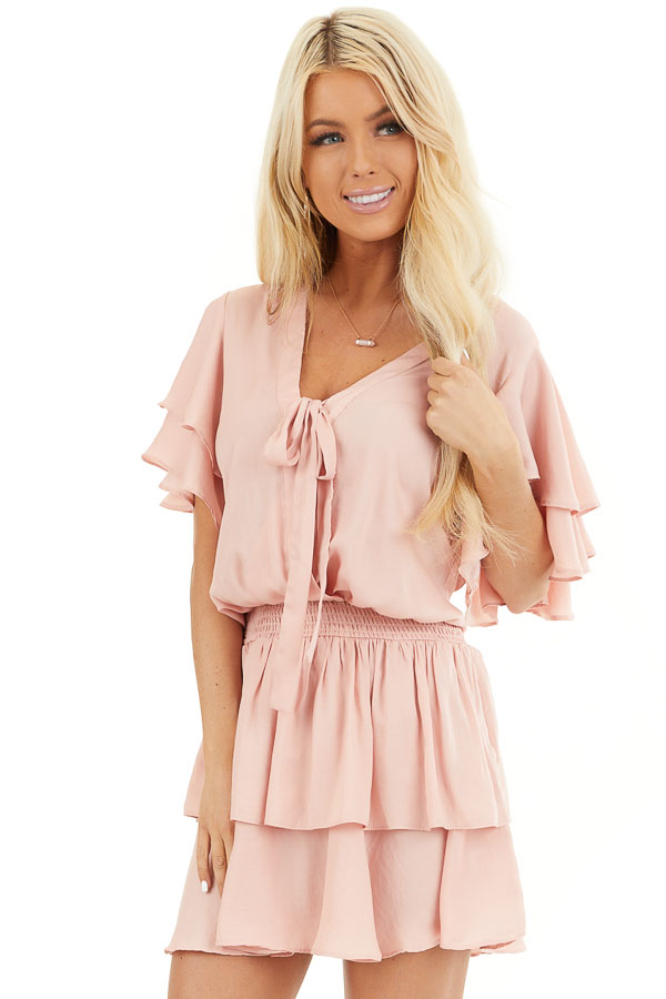 Blush Surplice V Neck Dress with Tie Detail and Ruffles front close up