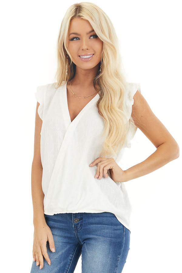 Off White Short Sleeve Surplice Blouse with Deep V Neckline front close up