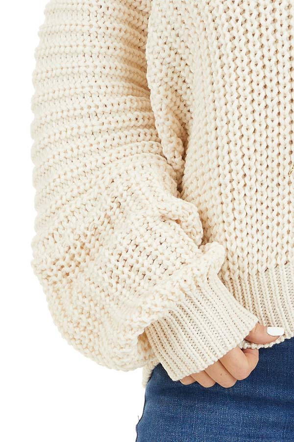 Ivory Cable Knit V Neck Sweater with Long Dolman Sleeves detail