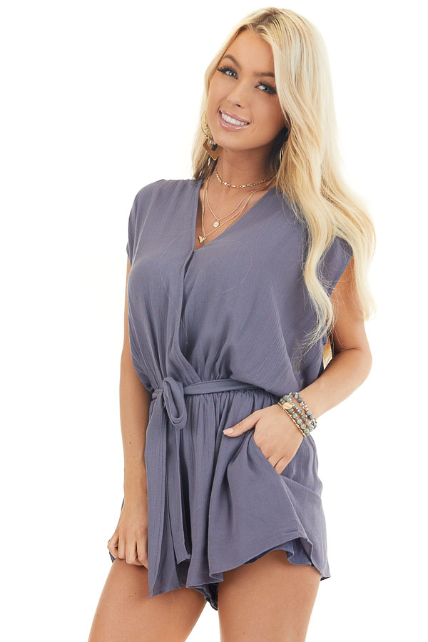 Dusty Blue Surplice Romper with Crochet Detail and Waist Tie front close up