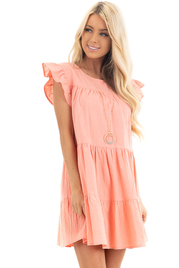 Coral Tiered Mini Dress with Ruffle Sleeves and Round Neck front close up