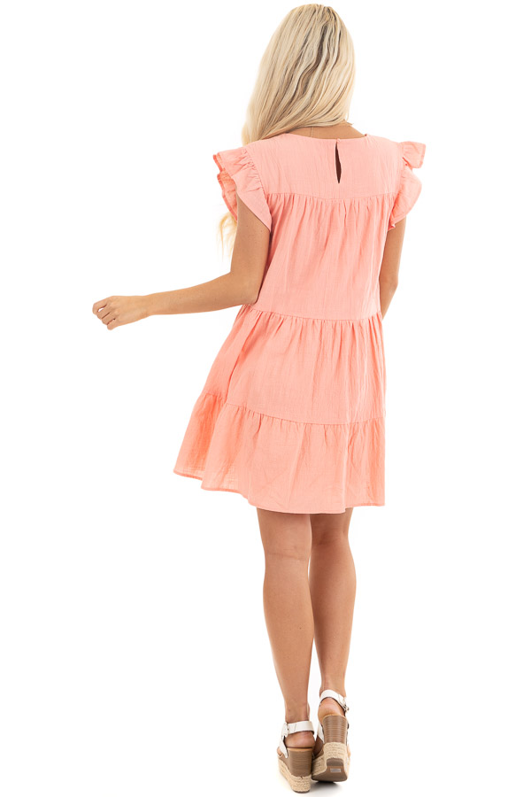 Coral Tiered Mini Dress with Ruffle Sleeves and Round Neck back full body