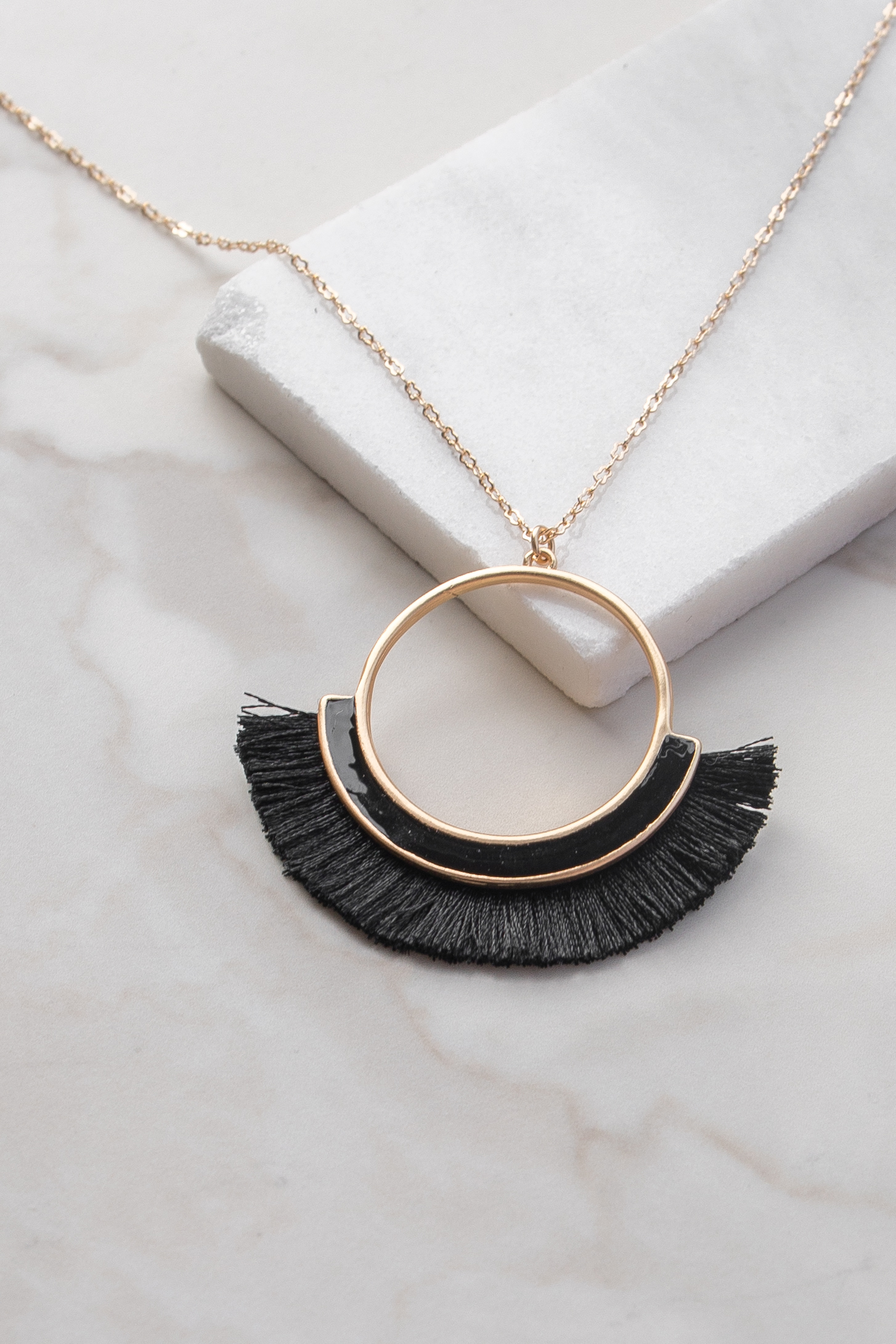 Gold Circle Charm Long Necklace with Black Tassel Detail