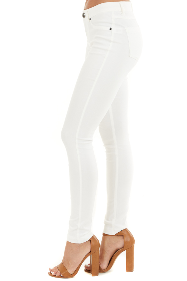 Pearl White Solid Colored Mid Rise Skinny Jeans side view