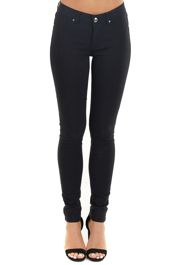 Black Solid Colored Mid Rise Skinny Jeans front view