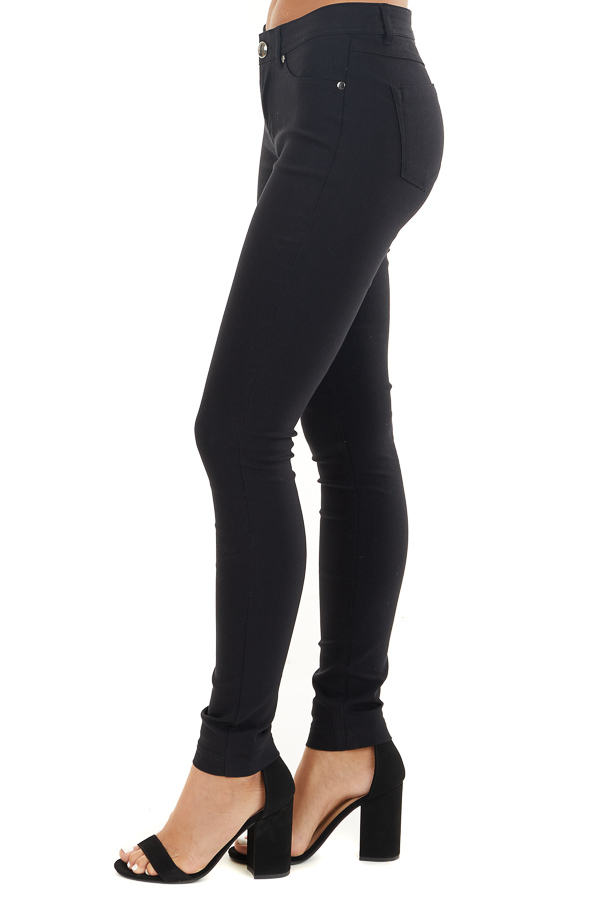 Black Solid Colored Mid Rise Skinny Jeans side view
