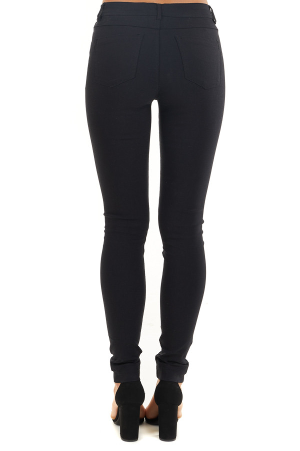 Black Solid Colored Mid Rise Skinny Jeans back view