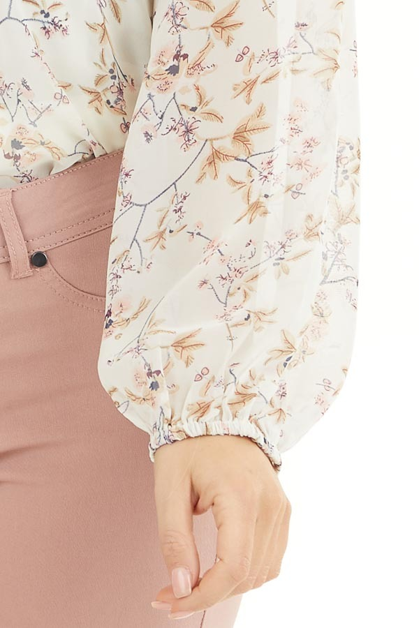 Ivory Floral Print Long Sleeve Woven Top with Cutout Front detail