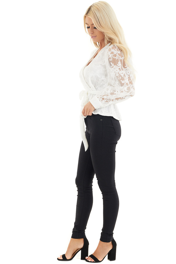 Pearl White Surplice Peplum Blouse with Floral Lace Details side full body