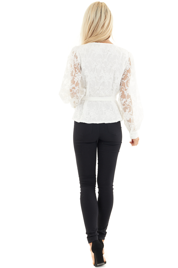 Pearl White Surplice Peplum Blouse with Floral Lace Details back full body