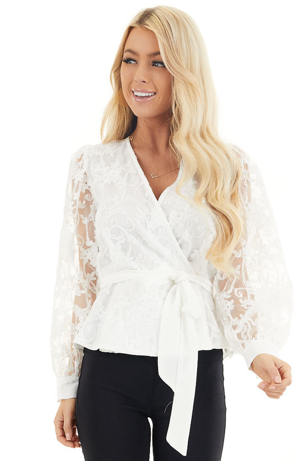 Pearl White Surplice Peplum Blouse with Floral Lace Details front close up