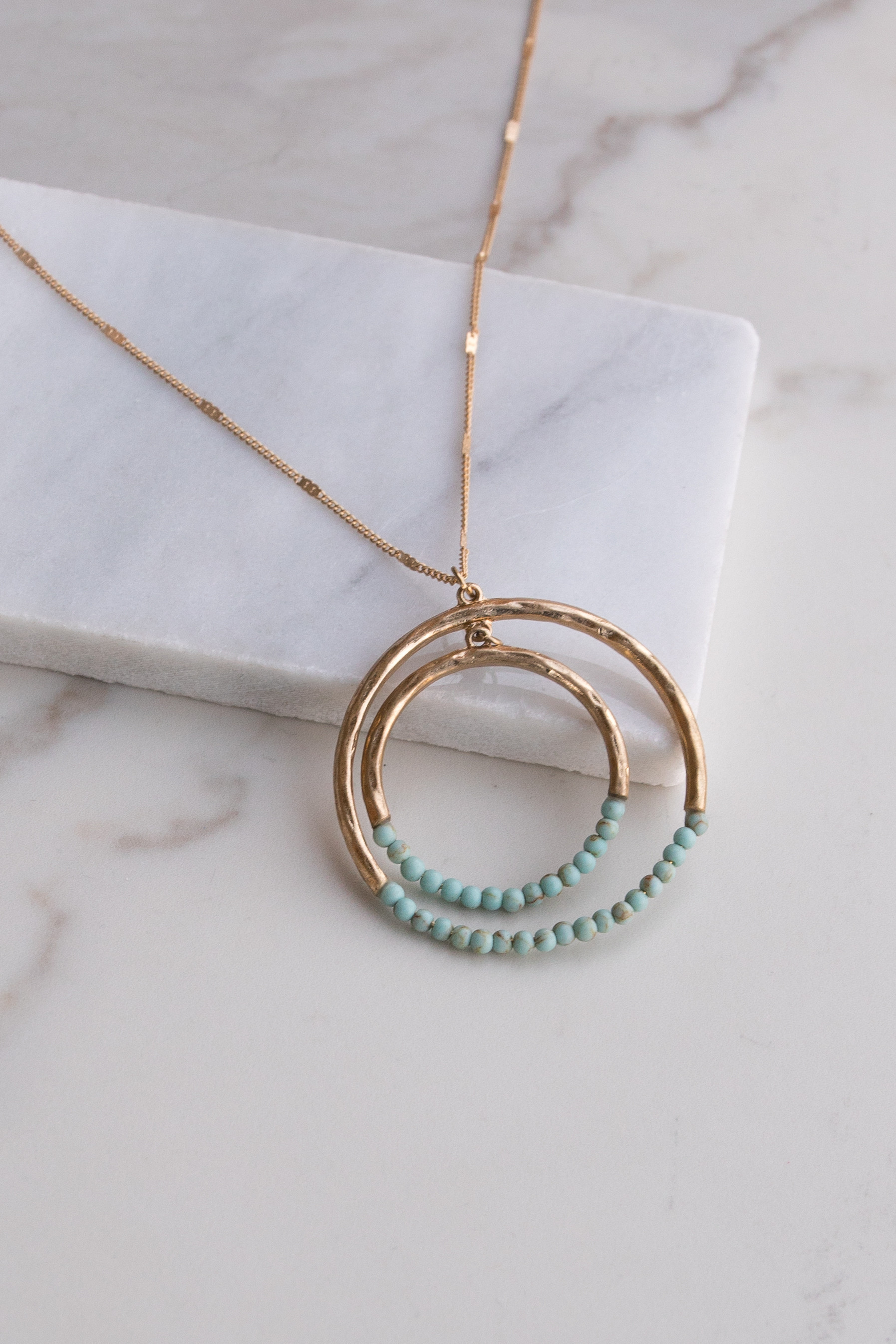 Gold Necklace with Double Hoop Pendant and Bead Details