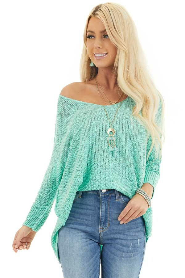 Mint Long Sleeve Knit Top with Side Slits and Exposed Seam front close up