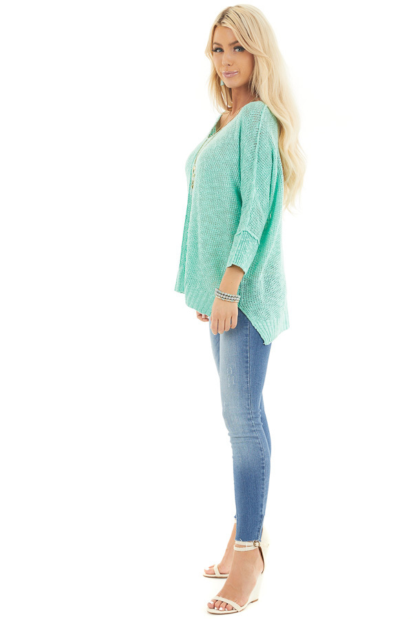 Mint Long Sleeve Knit Top with Side Slits and Exposed Seam side full body