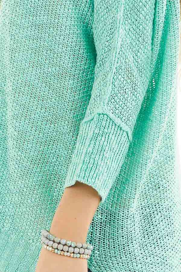 Mint Long Sleeve Knit Top with Side Slits and Exposed Seam detail