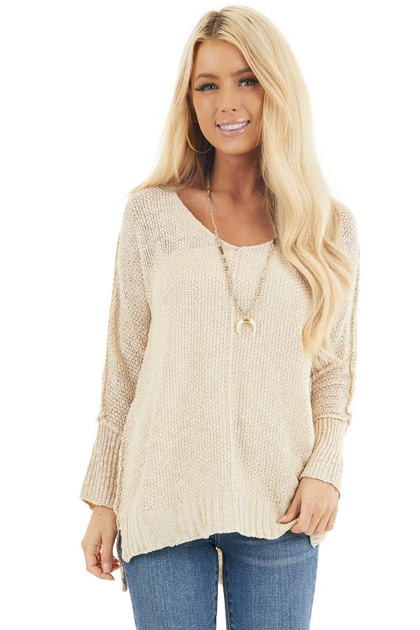 Beige Long Sleeve Knit Top with Side Slits and Exposed Seam front close up