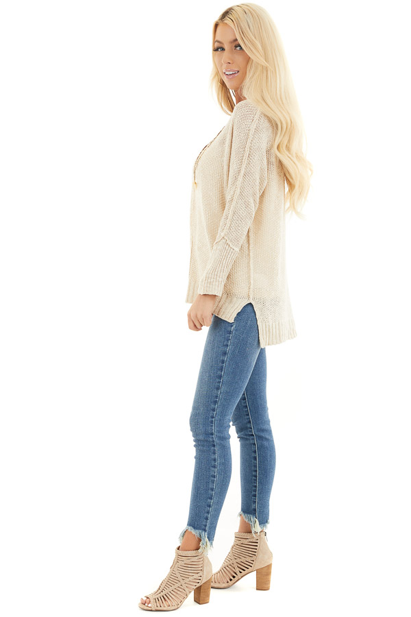 Beige Long Sleeve Knit Top with Side Slits and Exposed Seam side full body