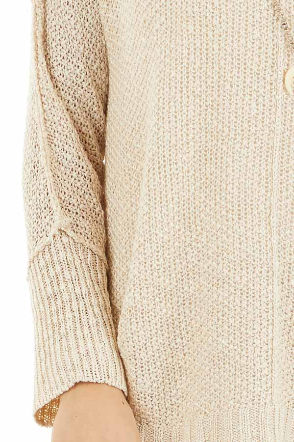 Beige Long Sleeve Knit Top with Side Slits and Exposed Seam detail