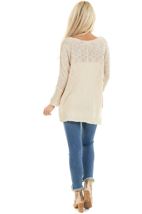 Beige Long Sleeve Knit Top with Side Slits and Exposed Seam back full body