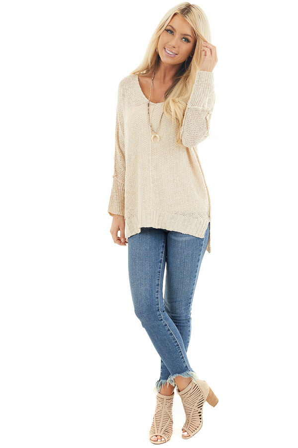 Beige Long Sleeve Knit Top with Side Slits and Exposed Seam front full body