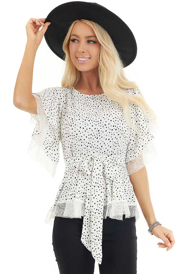 Pure White and Black Printed Peplum Top with Lace Details front close up
