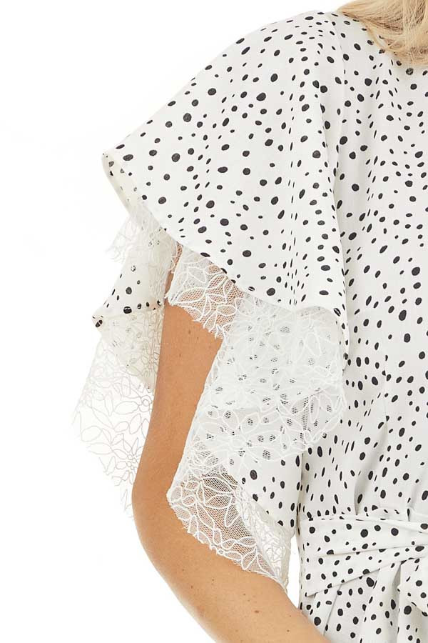 Pure White and Black Printed Peplum Top with Lace Details detail