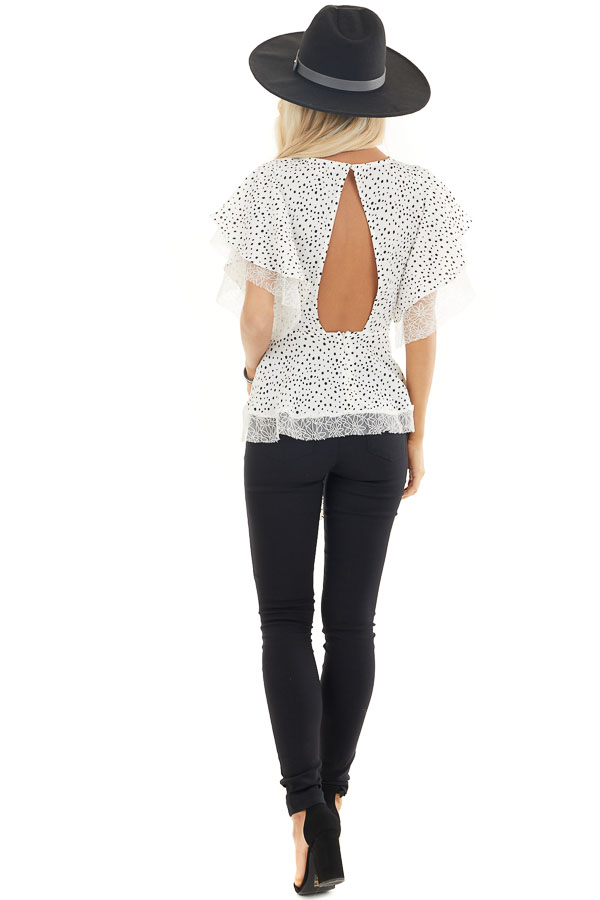 Pure White and Black Printed Peplum Top with Lace Details back full body