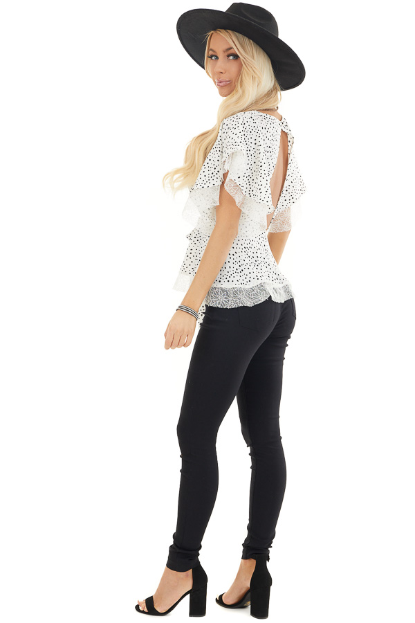 Pure White and Black Printed Peplum Top with Lace Details side full body