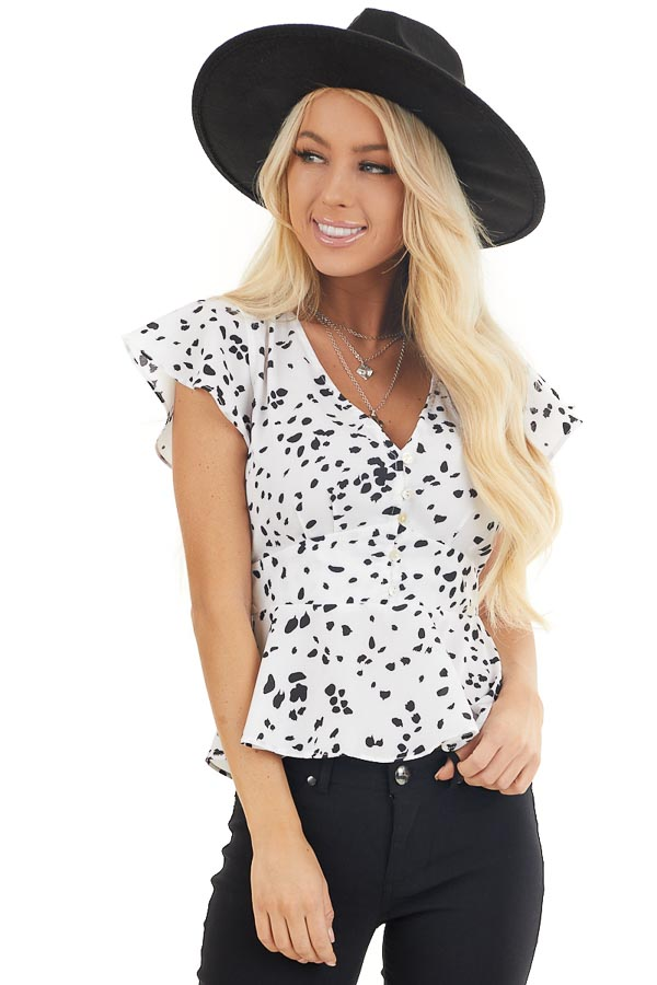Off White and Black Polka Dot V Neck Button Up Peplum Blouse front close up