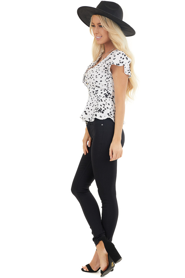 Off White and Black Polka Dot V Neck Button Up Peplum Blouse side full body