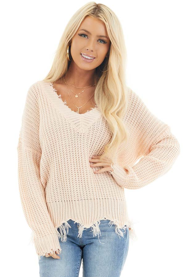 Soft Peach V Neck Sweater with Distressed Hemline and Cuffs front close up