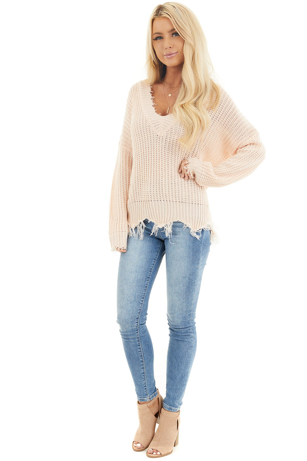 Soft Peach V Neck Sweater with Distressed Hemline and Cuffs front full body