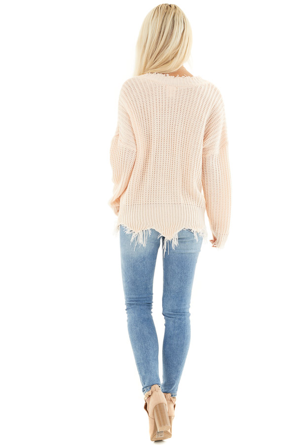 Soft Peach V Neck Sweater with Distressed Hemline and Cuffs back full body