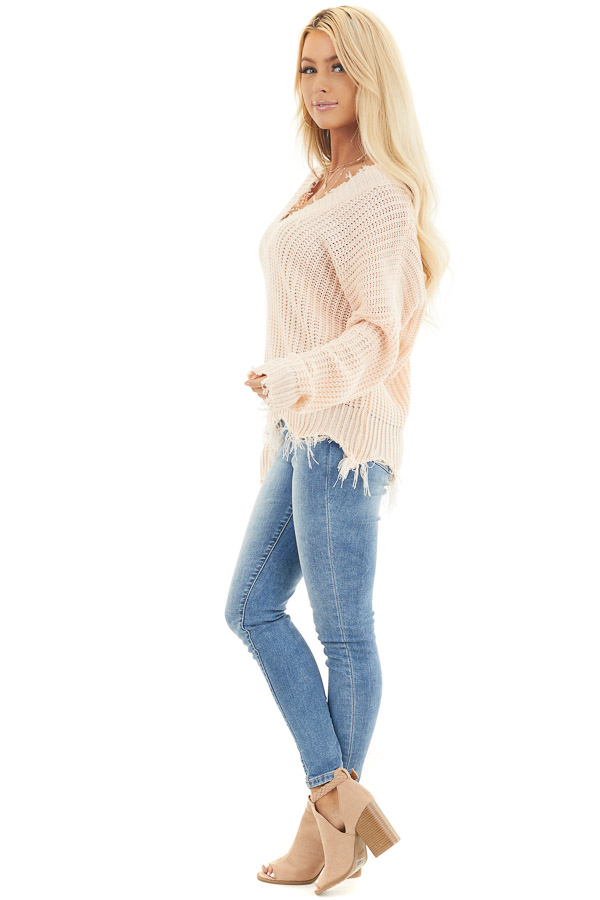 Soft Peach V Neck Sweater with Distressed Hemline and Cuffs side full body
