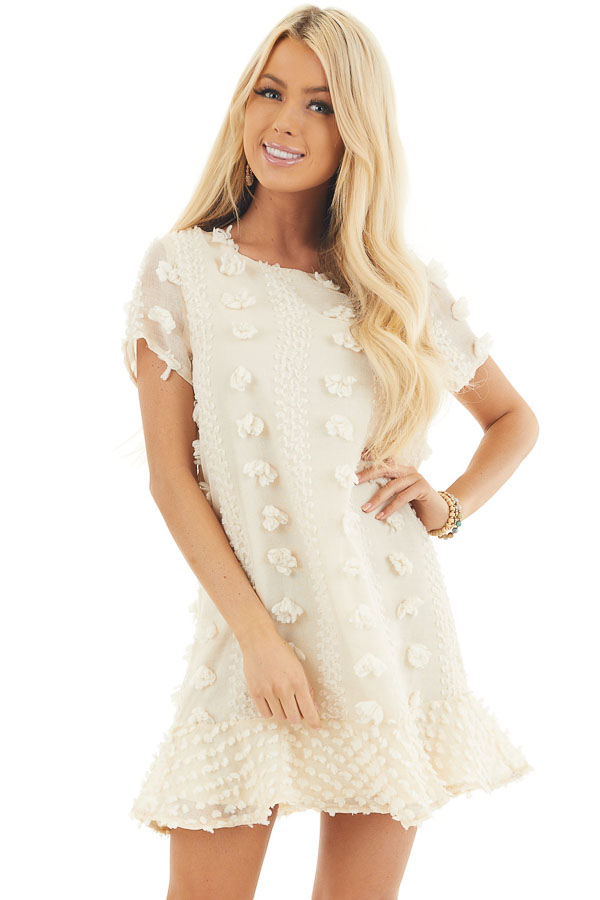 Cream Dress with 3D Textured Details and Ruffle Hemline front close up