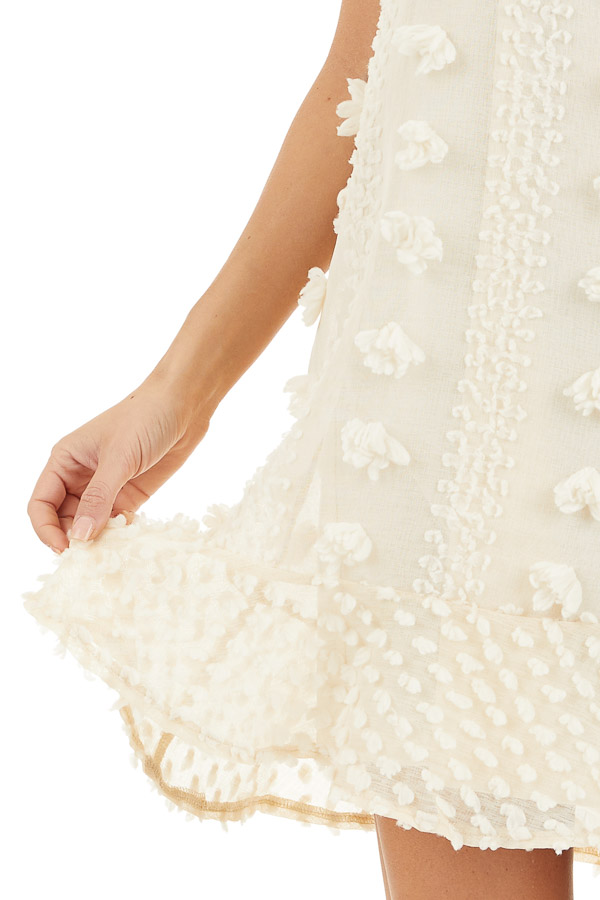 Cream Dress with 3D Textured Details and Ruffle Hemline detail