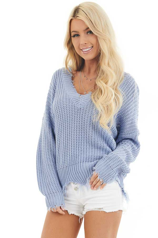 Dusty Blue V Neck Sweater with Distressed Hemline and Cuffs front close up
